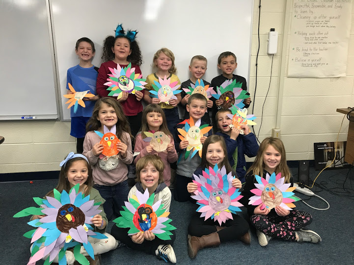 Mrs. Olson's class with their turkeys.