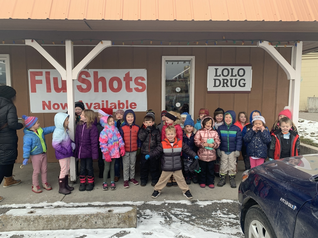 Mrs. Bramblett's and Mrs. Brown's class pose in front of Lolo Drug after donating 27 food items!