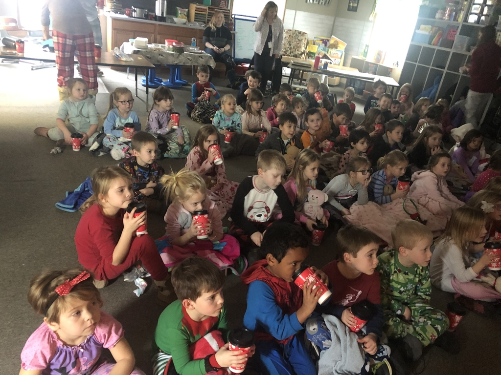 Kindergarten students watching Polar Express.