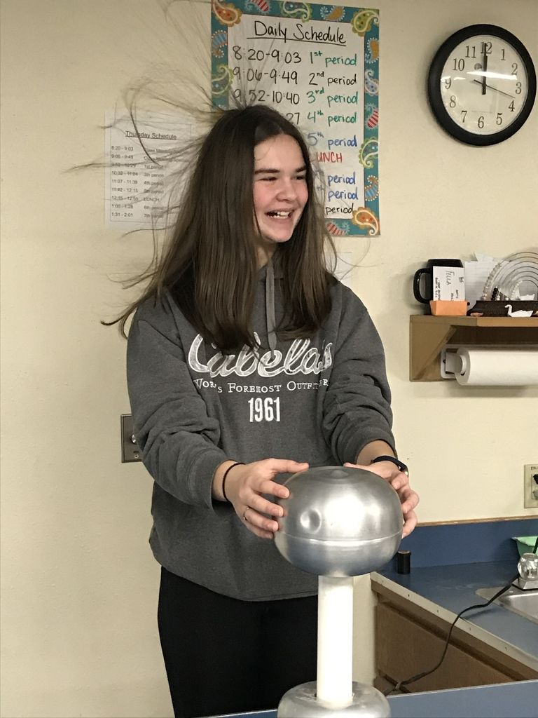 8th grade students learn about static electricity with the Van set Graaf generator.