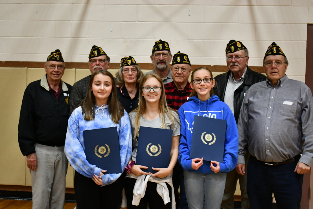 Kylie, Kendall, and Rori with their first, second, and third place certificates and cash prizes, in front of Lolo American Legion representatives.