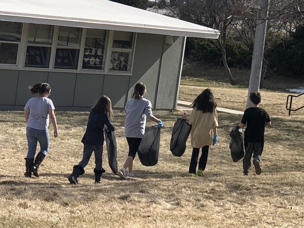 Fifth graders picking up litter